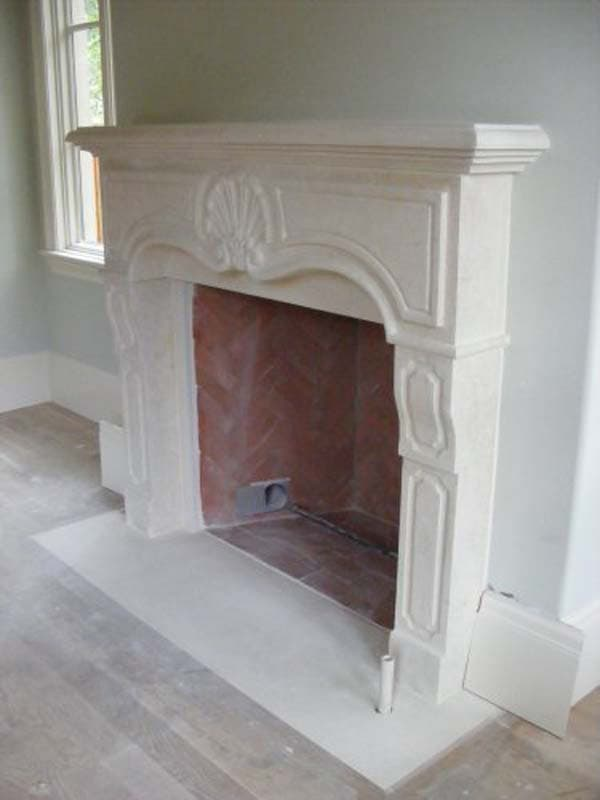 Specialty Stone - Hand Carved Fireplace | Metro Brick